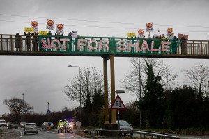 """Not for shale"" banner on motorway bridge demo in Upton Chester where fracking company IGas has permission to drill"